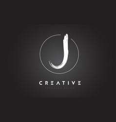 J brush letter logo design artistic handwritten vector