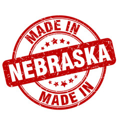 Made in nebraska red grunge round stamp vector