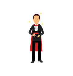 Magician in an elegant black suit and red cape vector