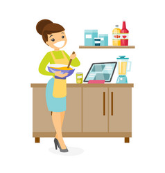 young caucasian white woman whisking dough vector image