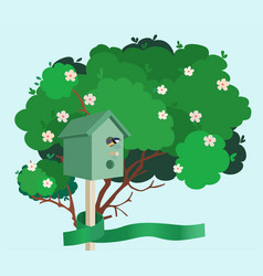 A green nesting box on a blossoming tree vector