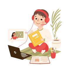 Boy in headphones studying online using laptop vector