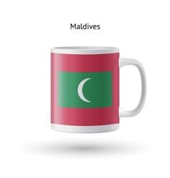 Maldives flag souvenir mug on white background vector