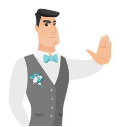 Young caucasian groom showing stop hand gesture vector