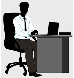silhouette man at the Desk with laptop vector image