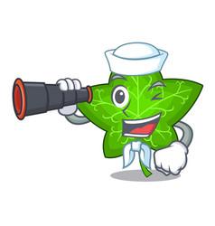 Sailor with binocular fresh green ivy leaf mascot vector