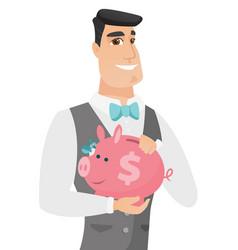 Caucasian groom holding a piggy bank vector