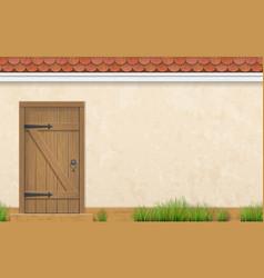 facade with old wooden door grass vector image