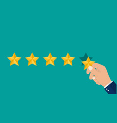 Hand puts 5 stars rating reviews five stars in vector