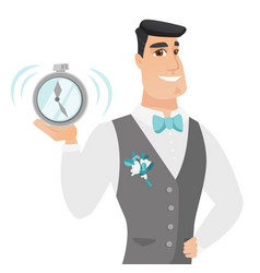 Young caucasian groom holding alarm clock vector