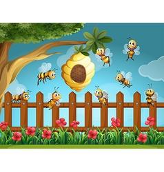 Bees flying around beehive in the garden vector image vector image