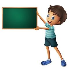 A boy holding an empty blackboard vector image vector image