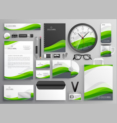 Green wavy business stationery set template vector