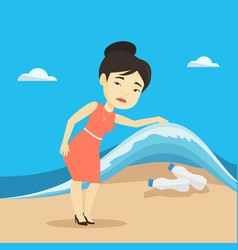 woman showing plastic bottles under sea wave vector image