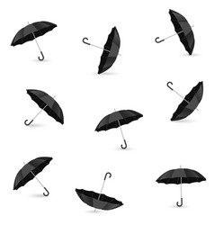 Seamless pattern with realistic black umbrellas vector