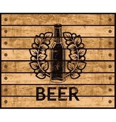 beer bottle on wooden box vector image