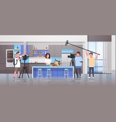 Operators using video camera recording food vector