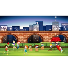 Children playing in the park at night vector image