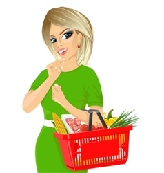 Woman holding an empty shopping basket vector