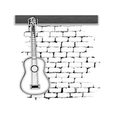 musical instruments guitar on the brick wall vector image vector image
