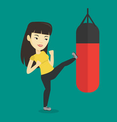 woman exercising with punching bag vector image