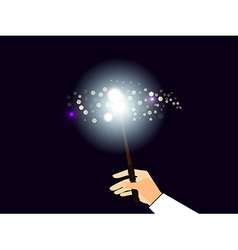 Hand holding a magic wand vector