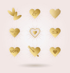 golden abstract hearts icons set with sun beams vector image