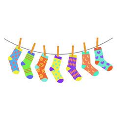 Set colorful bright children socks drying vector
