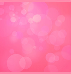 Pink background with bokeh vector