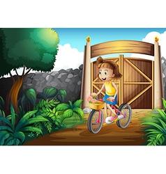 A child biking at the yard vector