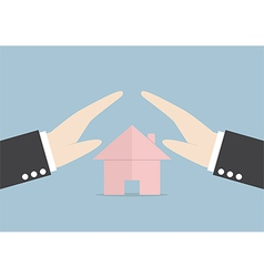 Businessman protect house by hands vector image