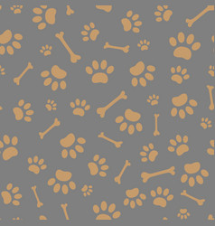 Seamless pattern of paws and bones vector
