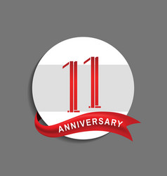 11 anniversary with white circle and red ribbon vector