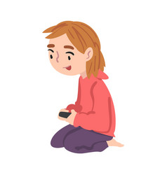 cute girl sitting on floor playing video game vector image