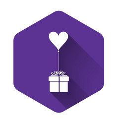 white gift with balloon in shape heart icon vector image