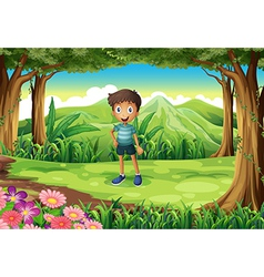 A jungle with a smiling little boy vector image