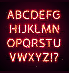 Glowing neon red alphabet with glitter on dark vector