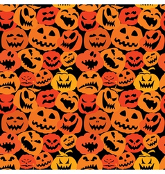Halloween seamless pattern with pumpkins faces vector