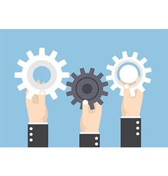 Hands holding gear or cog wheel teamwork vector image