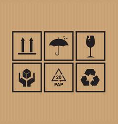 packaging symbols set on cardboard background vector image