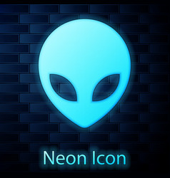 Glowing neon alien icon isolated on brick wall vector