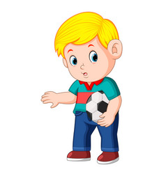 Boy standing and holding the ball vector