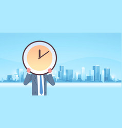 Businessman holding clock in front face vector