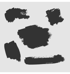 set grunge textured brush strokes on a white vector image