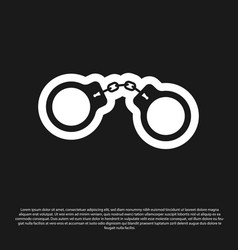 Black handcuffs icon isolated on black background vector
