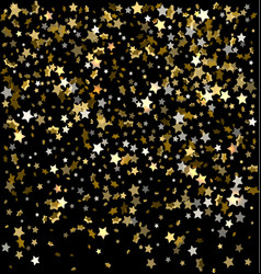 gold sparkles on a black background gold vector image vector image