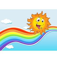 A sky with a rainbow and a happy sun vector image