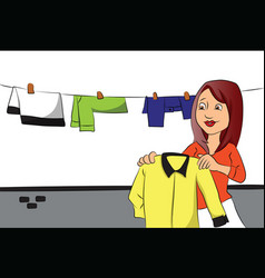 woman hanging clothes on clothesline vector image
