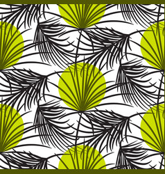 Gray palm leaves with green dots seamless vector