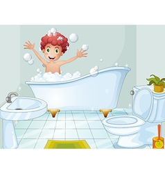 A cute boy taking a bath vector image